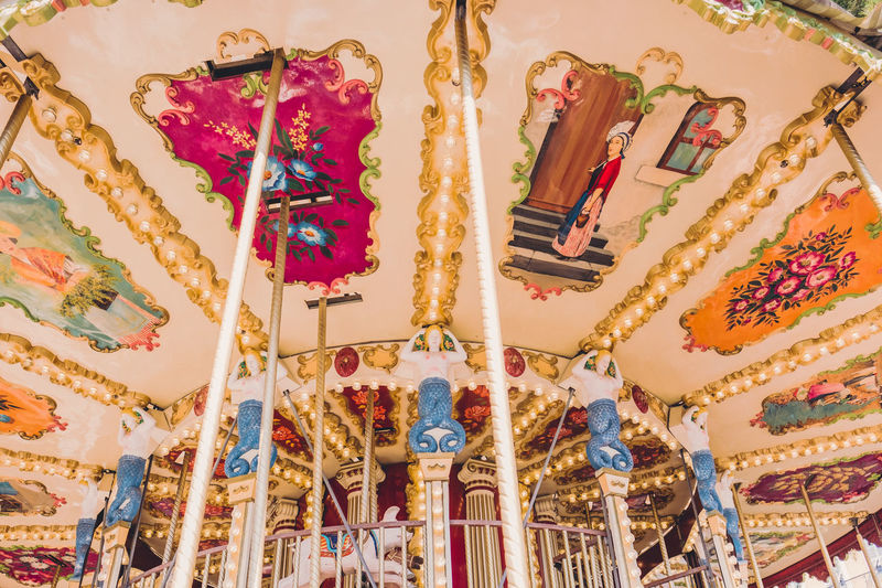 Low Angle View Representation Indoors  No People Multi Colored Art And Craft Creativity Amusement Park Human Representation Amusement Park Ride Choice Ceiling Belief Carousel Lighting Equipment Religion Arts Culture And Entertainment Spirituality Built Structure Close-up Ornate Carousel Horses