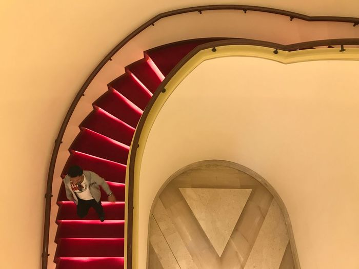 Interior architectural Staircase Steps And Staircases Steps Architecture Built Structure Railing Real People Indoors  Lifestyles Men Spiral Stairs Sitting Spiral Staircase Illuminated Day People Sheraton Hotel Qatar street photography doha interior design Tourist Attraction  Streetphotography Holidays Architecture
