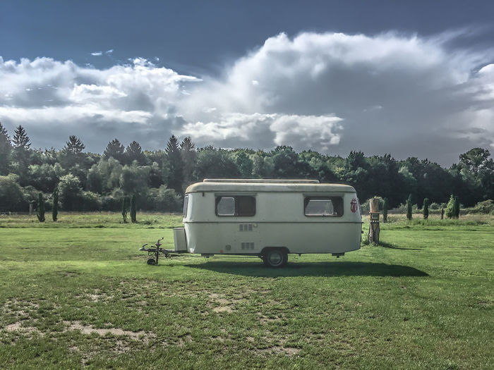 there are still some empty spaces for caravaners... Old-fashioned Camper Campervan Cloud - Sky Day Field Grass Land Vehicle Landscape Lonesome Mode Of Transport Nature No People Outdoors Sky Transportation Tree