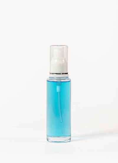 Close-up of blue bottle against white background