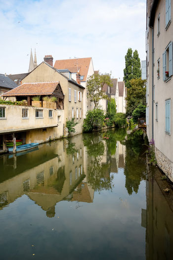 Architecture Beauty In Nature Building Building Exterior Built Structure Canal Chartres Cloud Cloud - Sky Day Nature No People Outdoors Reflection Residential Building Residential District Residential Structure Sky Standing Water Town Tranquility Village Water Waterfront