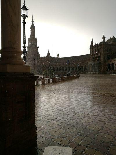 la lluvia en Sevilla es maravilla Sevilla Spain Miarma Plaza De España Water City Sky Architecture Building Exterior Rain Rainfall Umbrella Puddle Rainy Season Raincoat Weather Torrential Rain
