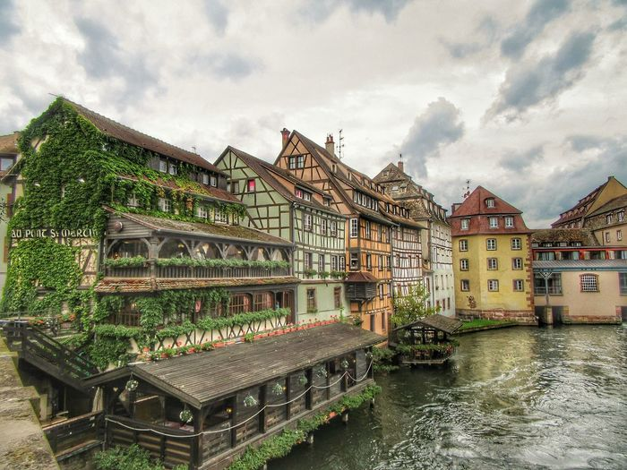 Architecture Cloud - Sky Built Structure Water Sky Building Exterior Outdoors No People Day Nature Reflection Strasbourg♥ Strasbourg Travel Destinations France Photooftheday PetiteFrance Alsace Vacations Lumicar Flower Streetphotography