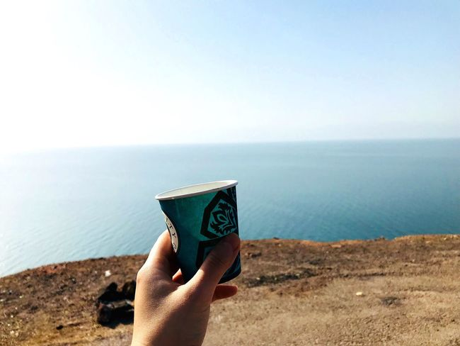 Drinking Turkish coffee at the Dead Sea Turkishcoffee Coffee Dead Sea  Jordan Sea Human Hand Horizon Over Water Water Real People One Person Sky Nature Clear Sky Holding Close-up Outdoors Day Scenics EyeEmNewHere