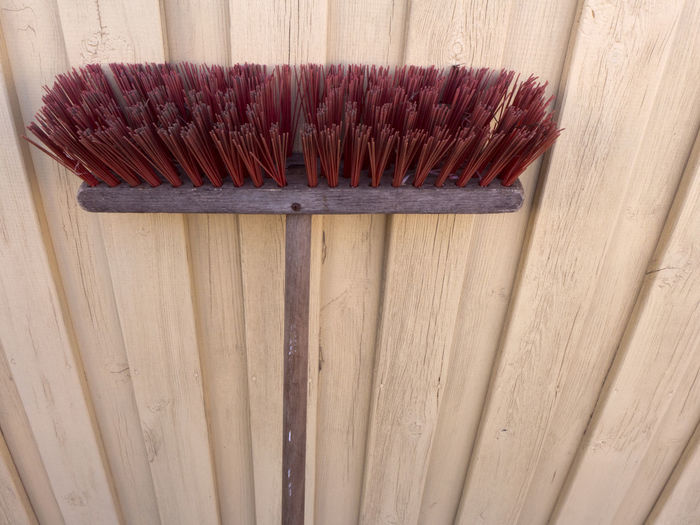 A street broom with rough red long bristles and wooden handle Broom Stick Handle Wooden Red Color Bristles Outdoors No People Day Outside Garden Photography Garden Tools Housekeeping Cleaning Cleaning Equipment Object Broomstick Brush Dirty Wood - Material Still Life Close-up Hygiene Side By Side In A Row Single Object