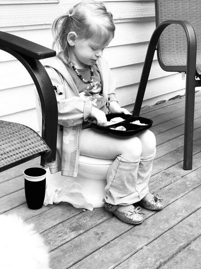 Multi-tasking—potty training and eating lunch—life of a two year old series Pottytraining Portrait Portraitist-2018 EyeEm Awards Sitting Childhood Real People One Person Child Full Length Casual Clothing Food And Drink