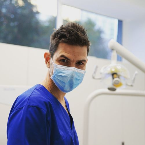 Dental People Day Portrait One Person Blue Happy Working Indoors  Oralsurgery Warsaw My Point Of View Enjoying Life EyeEmNewHere EyeEm Best Shots Occupational Safety And Health Hospital Surgical Mask Occupation Scrubs Portrait Healthcare And Medicine Men Looking At Camera Doctor  Operating Room Surgeon Protective Mask - Workwear Operating Surgery