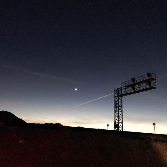 Sky No People Silhouette Nature Outdoors Low Angle View Railroad Signals Non-urban Scene Technology Beauty In Nature Moon Night Astronomy