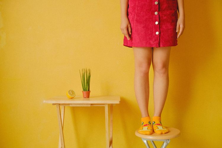 Limb Standing Low Section Human Leg Only Women One Person Adults Only People One Woman Only Human Body Part Indoors  Yellow Adult One Young Woman Only Young Adult Portrait Multi Colored Yellow Background Lifestyles Young Women