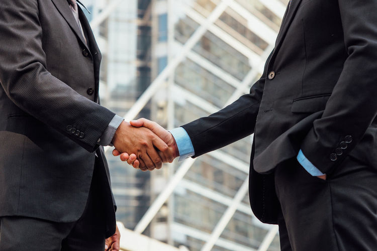 Cropped image of businessmen shaking hands