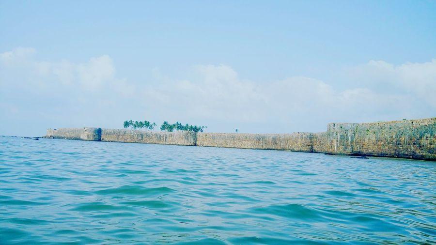 Calm & Clear Tree Coconut Trees Land In Sea Island Islandcastle #EyeEmNewHere Fort Water Fort Castle Castlewall Waterride Water Sea Beach Blue Summer Sky EyeEmNewHere