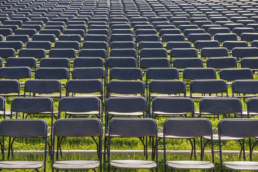 Grass Absence Abundance Arrangement Backgrounds Chair Conference Day Empty Full Frame Green Color High Angle View In A Row Large Group Of Objects No People Order Ordered Outdoors Plenary Session Repetition Seat Side By Side Sport Stadium Sunlight
