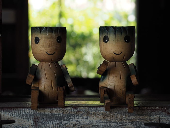 Close-up of wooden toy figurines on table