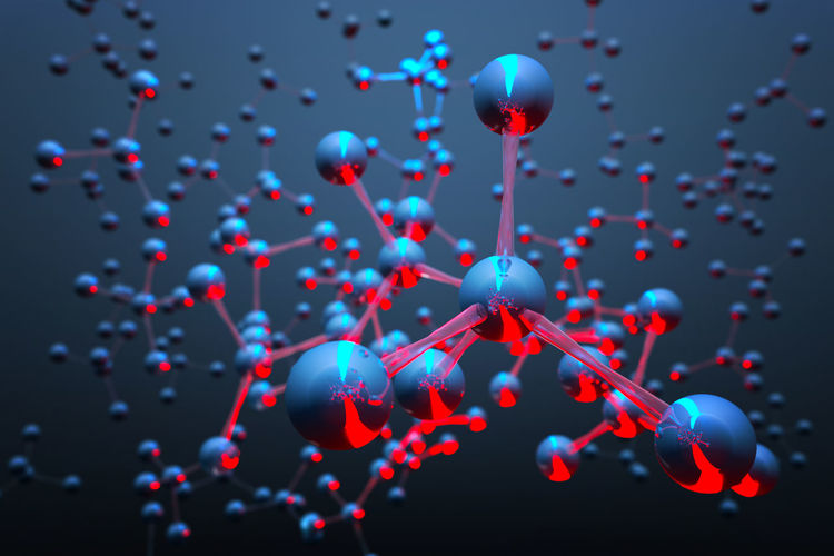 Close-up of molecular structure against blue background