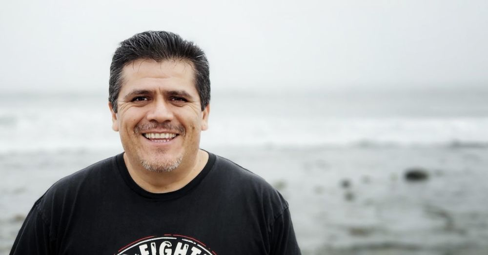 Portrait Of Smiling Man Against Sea