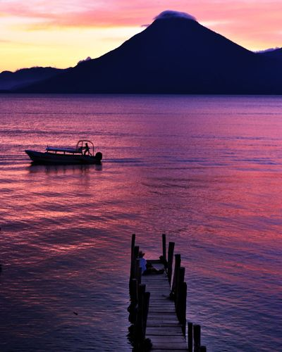 Invite Tranquility, no matter how big a shadow cast over you Sunset Landscape Nautical Vessel Tourism Sea Tranquility Reflection Outdoors Water Vacations Travel Destinations Beauty In Nature Red Cloud - Sky Scenics Mountain Silhouette Nature No People Beach Guatemala Lake Atitlan Atitlan Lake Panajachel  Perspectives On Nature EyeEmNewHere AI Now