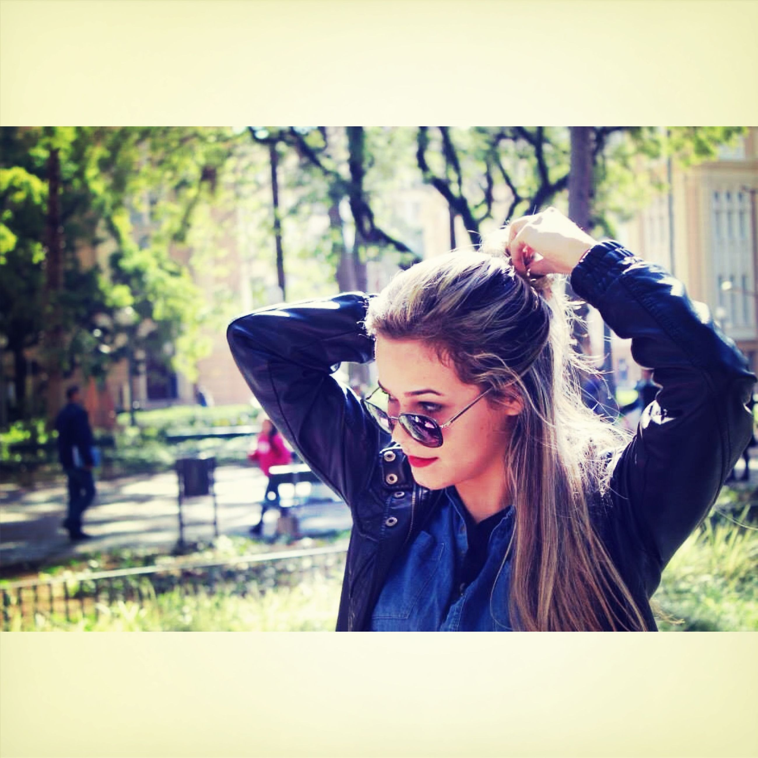 lifestyles, person, young adult, focus on foreground, leisure activity, casual clothing, young women, transfer print, side view, waist up, long hair, holding, sitting, smiling, auto post production filter, tree, three quarter length, headshot