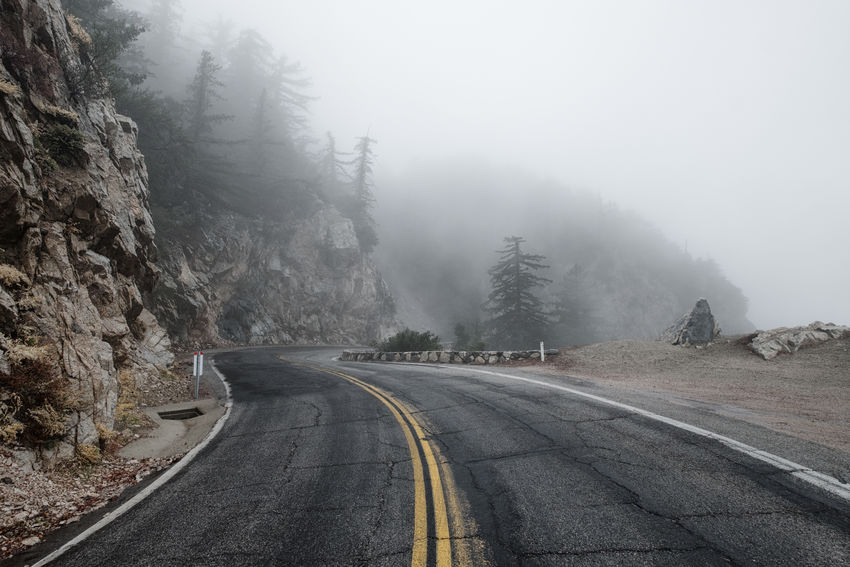 High mountain road in the clouds. Beauty In Nature Cold Temperature Day Fog Foggy Landscape Mountain Mountain Road Nature No People Outdoors Road Scenics Sky The Way Forward Tranquil Scene Tranquility Transportation Tree Weather Winding Road Winter California Dreamin