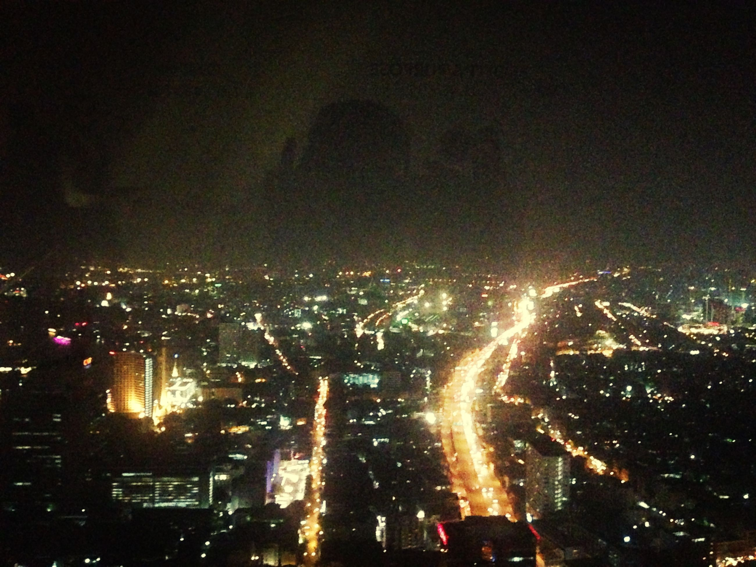 illuminated, night, cityscape, city, crowded, building exterior, architecture, built structure, high angle view, sky, aerial view, city life, residential district, dark, light - natural phenomenon, glowing, outdoors, residential building, skyscraper, residential structure