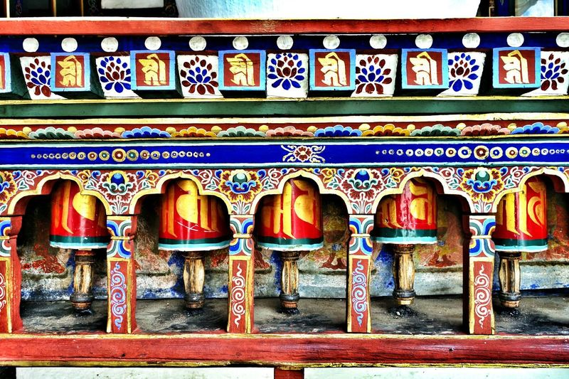EyeEmNewHere No People Multi Colored Outdoors Pattern Ornate Design Art And Craft Built Structure Architecture Red Colourful Bhutanese Architecture Bhutanese Culture Bhutan_ig Bhutan_places Prayerwheels
