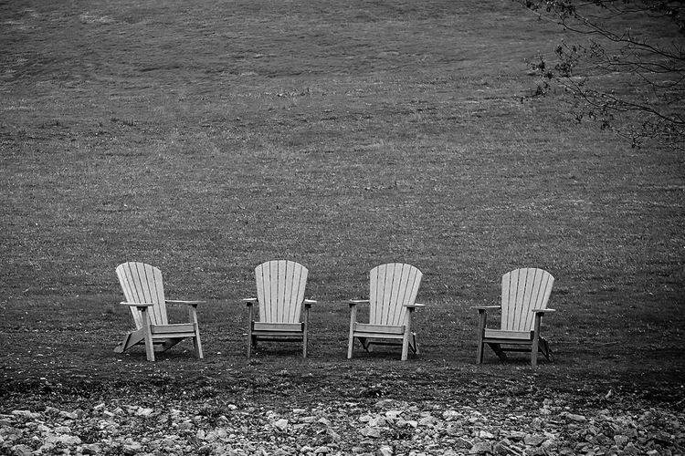 High angle view of empty chairs on beach