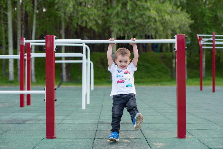 Full length of cute boy in park