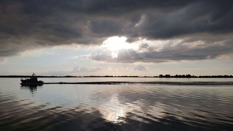 Water Sea Tranquility Cloud - Sky Beauty In Nature Reflection Nature Extreme Weather Landscape Sunset Outdoors Horizon Over Water No People Baltic Sea Ostsee Tranquility Spaetsommer Wanderlust Hiddensee Boat Rügen Sonnenuntergang Romantic Sky Ruegen Island Sunlight
