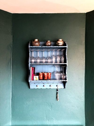 Close-up of bottles against wall