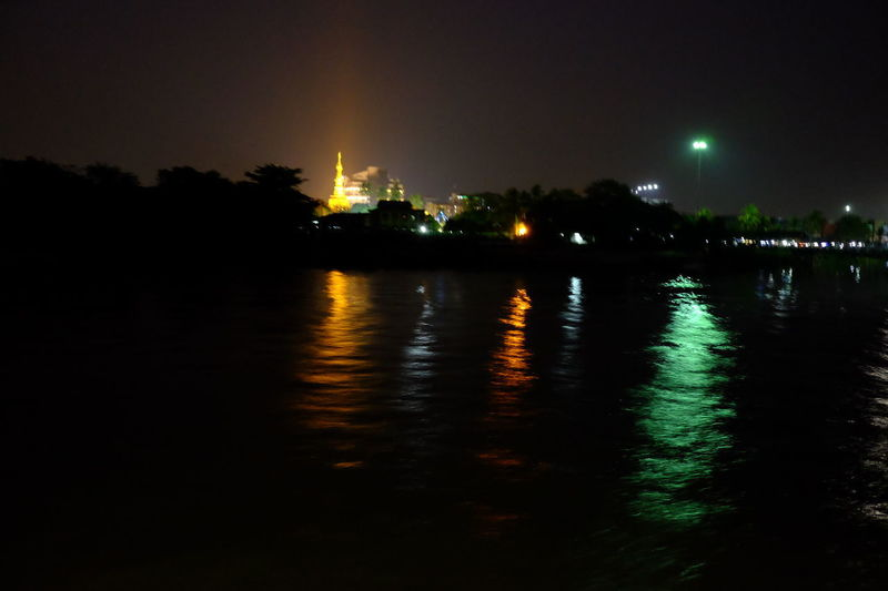 Illuminated Botataung Pagoda in Background at Night Ayeyarwady River Botataung Pagoda City Cityscape Composition Distant View Full Frame Illuminated Lighting Up The Sky Myanmar Night Night Photography Night Sky No People Outdoor Photography Reflections On The Water Ripples In The Water River River Bank  Shining Light Tourist Attraction  Tourist Destination Travel Destination Water Yangon