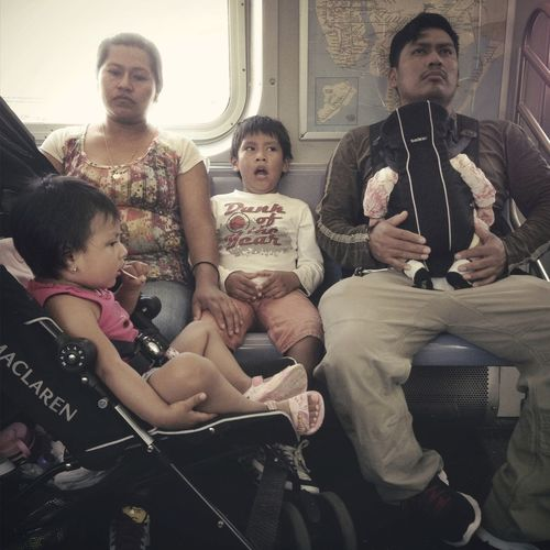 A family, that's also tiring. IPhoneography Subway Candid