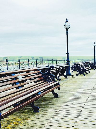 Water Outdoors Sky In A Row Day Sea Nature Tranquility Scenics No People Beauty In Nature Travel Destinations Horizon Over Water Pier Swanage Pier Street Lamp Decking Decking Wood