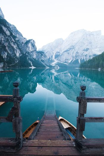Mountain Mountain Range Snow Winter Cold Temperature Water Scenics Wood - Material Lake Beauty In Nature Nature Weather Travel Destinations Tranquil Scene Pier Tranquility Outdoors No People Snowcapped Mountain Landscape