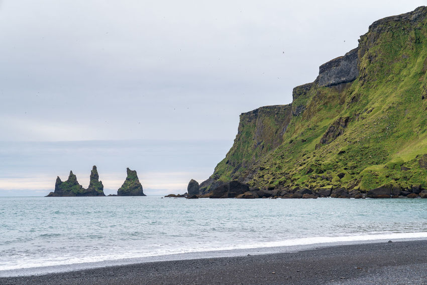 Black Sand Beach Iceland Beach Beautifuliceland Beauty In Nature Cliff Day Horizon Over Water Land Mountain Nature No People Outdoors Rock Rock - Object Rock Formation Scenics - Nature Sea Sky Solid Stack Rock Tranquil Scene Tranquility Water