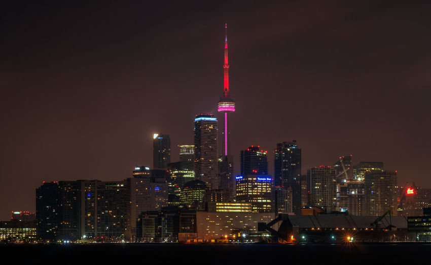 Toronto skyline at night Building Exterior Architecture Illuminated Built Structure City Tall - High Night Building Office Building Exterior Skyscraper Tower Cityscape Landscape Modern Financial District  Toronto Skyline Urban Skyline Night Photography Long Exposure No People CN Tower