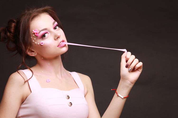 Black Background Bright Colors Bubble Wand Bubbles Colour Your Horizn Desert Food And Drink Happiness Lipstick Bubblegum Candy Fashion Model Food Glamour Headshot Holding Leisure Activity Pink Color Purple Ready-to-eat Sweet Sweet Food