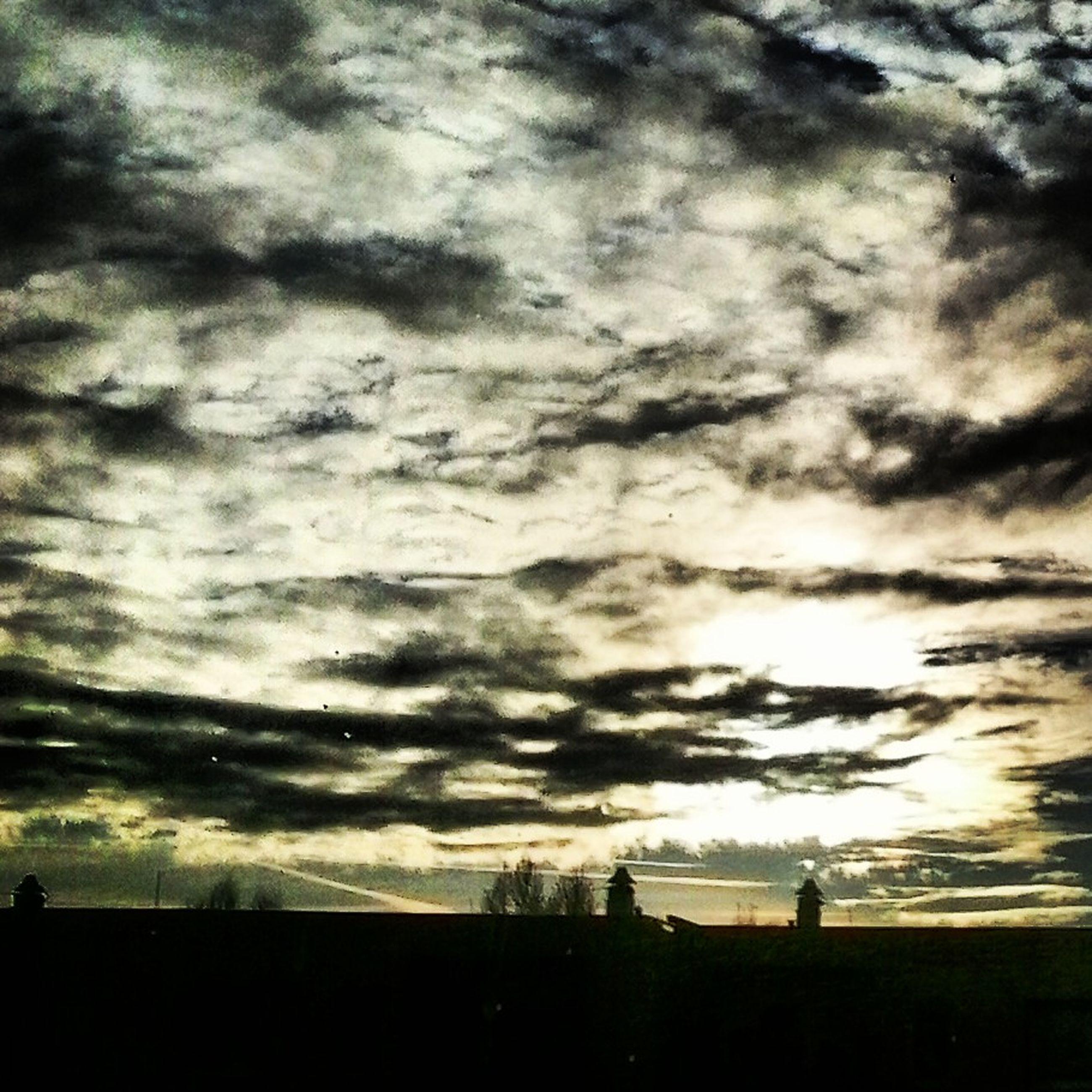 sky, cloud - sky, silhouette, cloudy, weather, sunset, beauty in nature, tranquil scene, scenics, overcast, tranquility, cloud, dramatic sky, storm cloud, nature, dusk, cloudscape, landscape, atmospheric mood, field