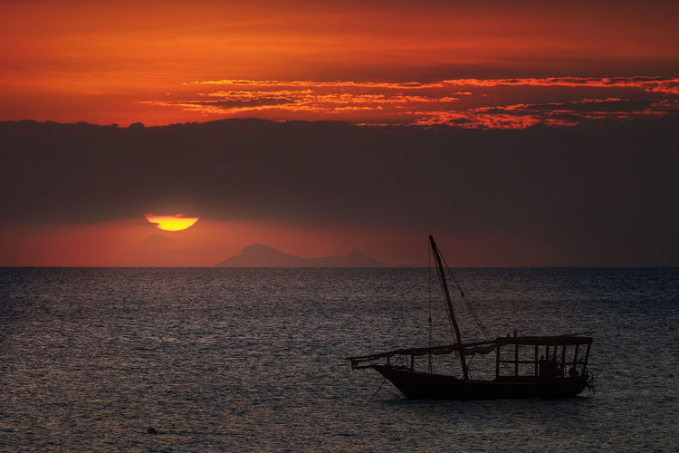 One of the most beautiful places to see a sunset is on the north shore of Zanzibar. Truly epic in nature Zanzibar Africa Beauty In Nature Cloud - Sky Fishing Boat Horizon Horizon Over Water Idyllic Nature Nautical Vessel No People Non-urban Scene Orange Color Outdoors Sailboat Scenics - Nature Sea Silhouette Sky Sun Sunset Tranquil Scene Tranquility Water Waterfront