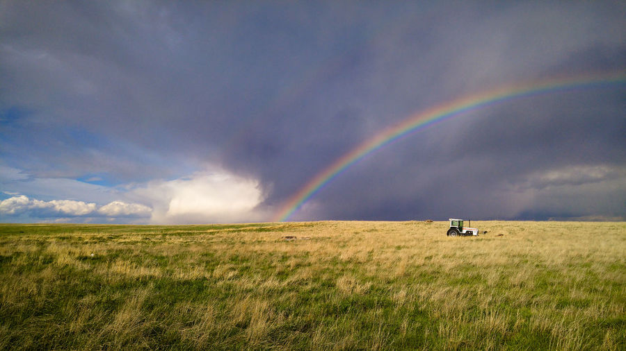 View from a ranch on the plains of eastern colorado, rainbow and tractor