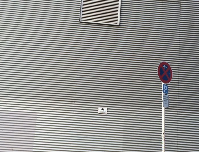 Urban Geometry Lines Façade metal sheet cover fuzzy parallels no parking Traffic Sign grey white