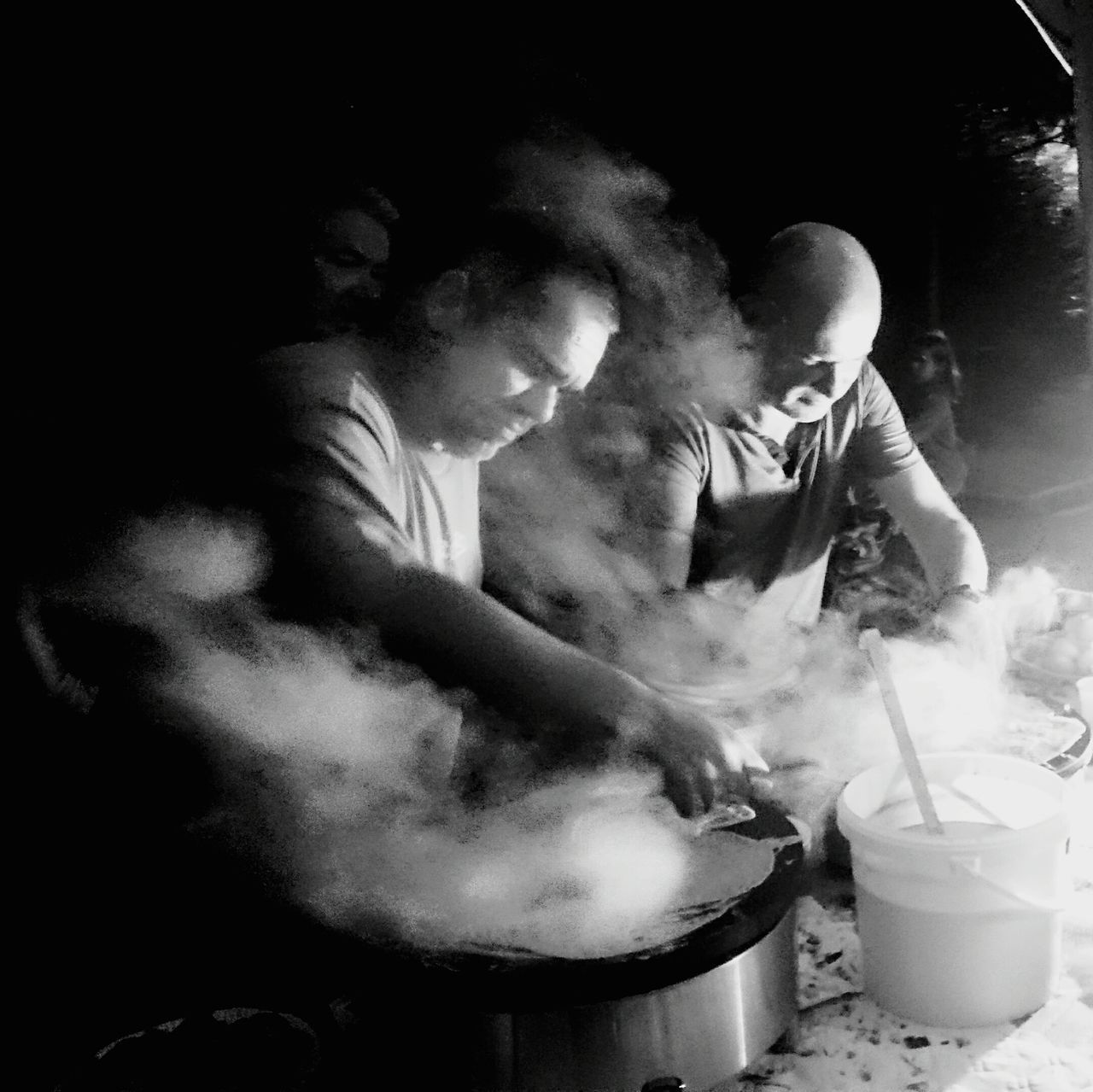 smoke - physical structure, burning, flame, real people, chef, indoors, night, men, food, young adult, people
