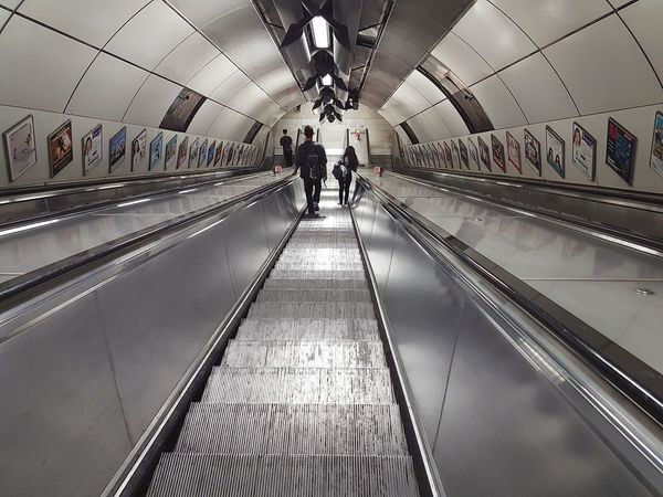 Indoors  Motion Escalator Transportation Convenience Modern Technology The Color Of Technology Connection The Way Forward On The Move Subway Station Built Structure Architecture Postcode Postcards Lost In London Passenger Moving Walkway  City Life Ceiling Journey People London Lifestyle in City Of London United Kingdom