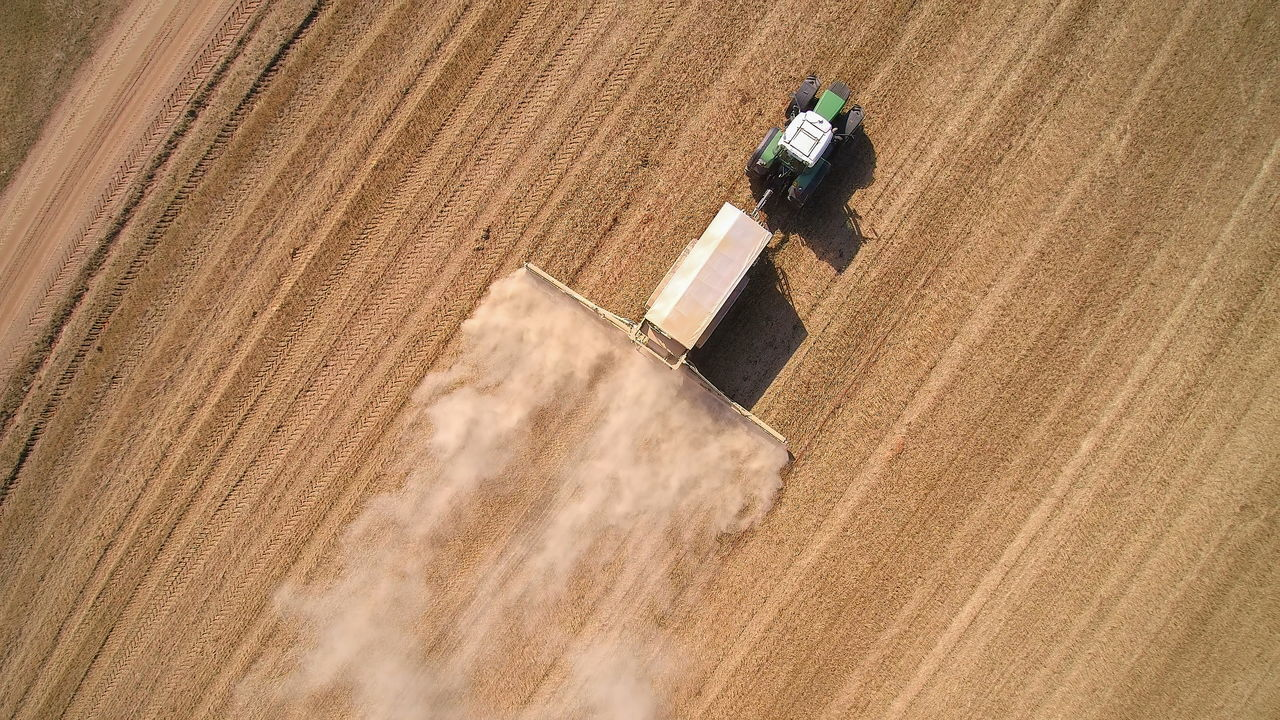 HIGH ANGLE VIEW OF PERSON WORKING ON FARM