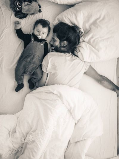 father and baby taking a nap in the afternoon Nap Sleeping Dungarees Cuddling Fatherhood Moments Parenthood Daddy Furniture Bed Childhood Child Women Females Relaxation Baby Young Togetherness Family Adult Indoors  High Angle View Real People Lying Down Bedroom Resting Two People