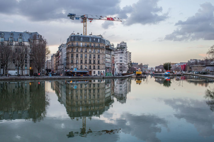 canal de l'Ourcq et canal St Denis Immeubles Canal Crepuscules Reflets Grue Travaux City Water Politics And Government Reflection Cityscape Sky Architecture