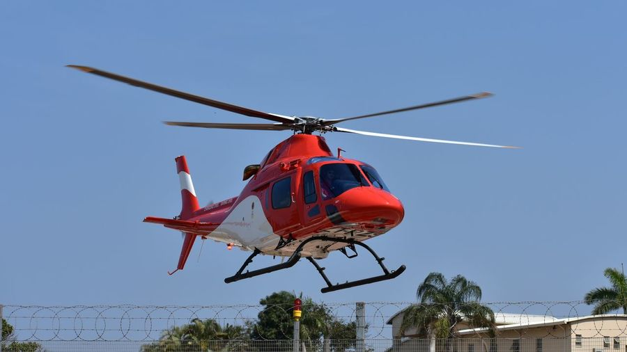 Air Ambulance. Saving People's Lives Emergency Services Urgent Hospital Transfers Sick People Transportation Critical Patients' Hospital Transfer Air Ambulance  Patients Transportation Take Off Airborne Rotor Blades Saving Life Tree Flying Red Air Vehicle Photography Themes Helicopter Sky Office Building Propeller #urbanana: The Urban Playground