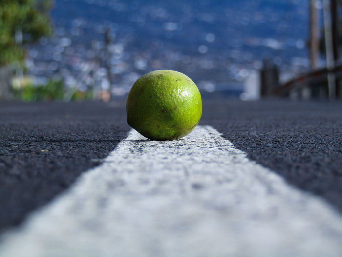 lemon in a road Fruit Selective Focus Healthy Eating No People Green Color Road Close-up First Eyeem Photo