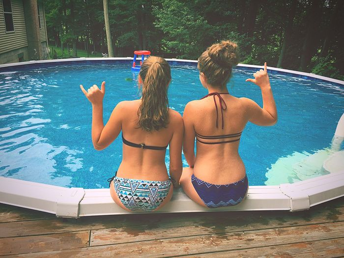 EyeEm Selects Water Rear View Two People Swimming Pool Summer Bikini Leisure Activity Vacations Day Human Body Part People Sitting Lifestyles Only Women Togetherness Real People Adult Outdoors Adults Only Young Adult First Eyeem Photo