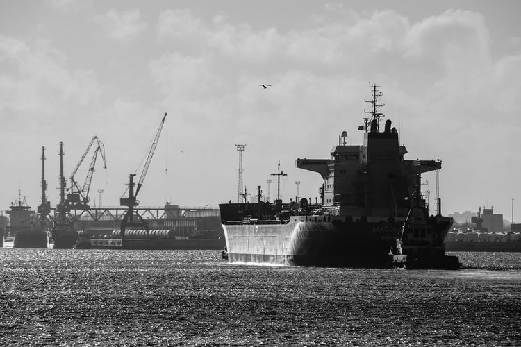 Ship Sailing In Sea By Commercial Dock