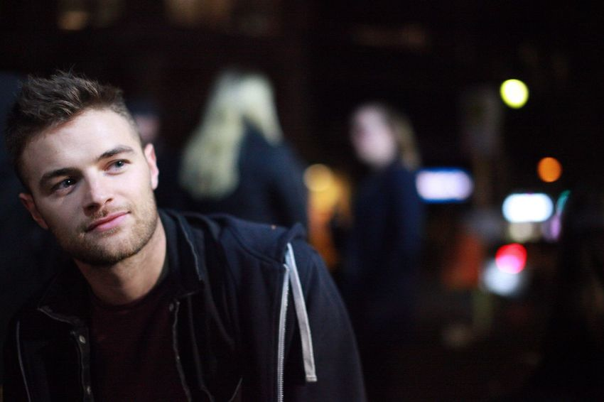 Young man sitting outside Focus On Foreground Night One Person Illuminated Portrait Real People Men Young Adult Indoors  One Man Only Close-up Only Men Adult People Adults Only Potrait