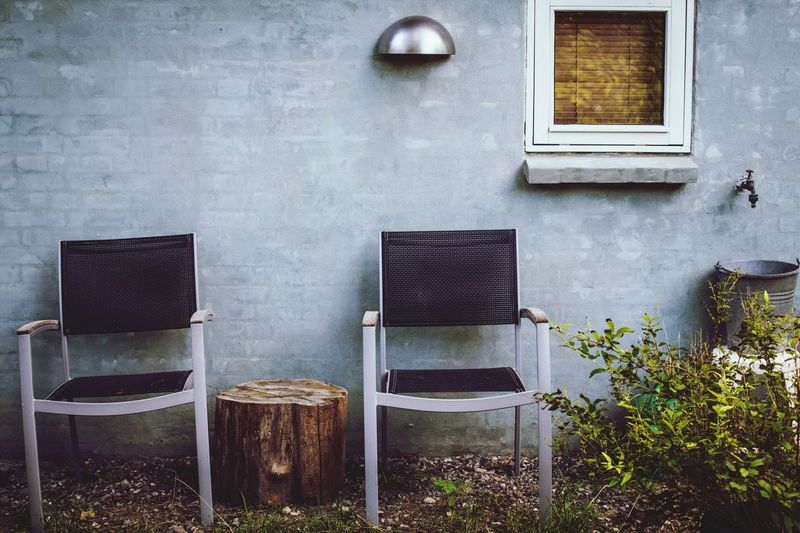 Chairs By Wall Outside